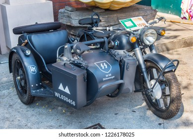 DALIAN, LIAONING, CHINA - 22JUL2018: BMW motor bike and sidecar, in the livery of the Dirlewanger Brigade a notorious unit of the Waffen SS. Provenance of motor bike is unkown.