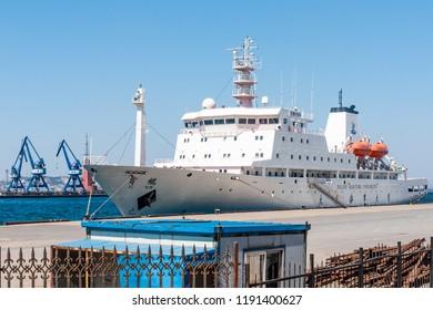 Dalian, Liaoning, China - March 25 2012: Ship YUKUN of the Dalian Maritime University, anchoring in Dalian Harbour