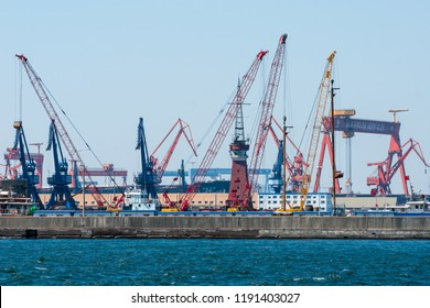 Dalian, Liaoning, China - March 25 2012: Crane booms in Dalian Shipyard