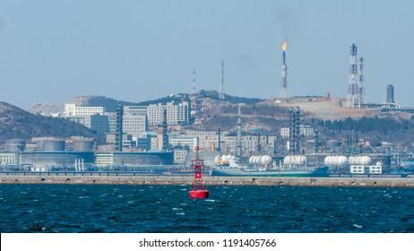 Dalian, Liaoning, China - March 25 2012: Dalian Harbour with Dalian PetroChina Refinery Plant