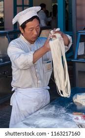 Dalian, Liaoning, China - May 18 2009: A Noodlemaker in Dalian Laohutan Ocean Park