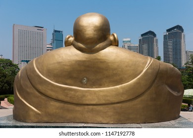 Dalian, Liaoning, China - May 21 2009: Backside view of the giant Buddha statue in Dalian Labour Park.
