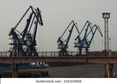 Dalian, Liaoning, China - May 21 2009: Crane booms in Dalian Harbour