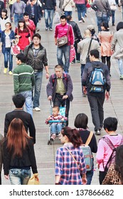 DALIAN-CHINA-OCT. 14, 2012. Crowd on Oct 14, 2012 in Dalian. With a population of over 1.3 billion and dwindling natural resources, China is concerned and has a ??one-child policy??, family planning.