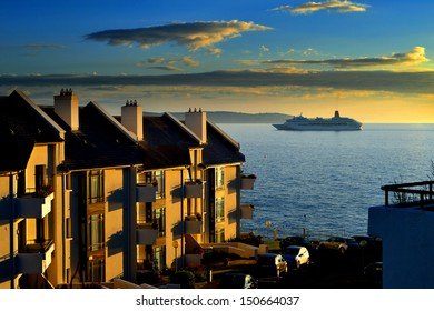 DALKEY, IRELAND - CIRCA JULY: The P&O cruise ship Oriana enters Dublin Bay at dawn during its tour of the British Isles circa July, 2013 in Dalkey, Ireland.