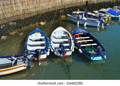 DALKEY, IRELAND - CIRCA JULY: Small motor boats moored at Bulloch Harbour circa July, 2013 in Dalkey, Ireland.