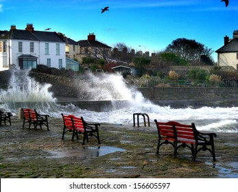 DALKEY, IRELAND - CIRCA NOVEMBER: Large waves crashing into sea defences near Bulloch Harbour circa November 2012 in Dalkey, Ireland.