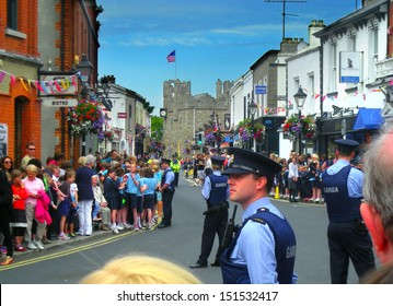 DALKEY, IRELAND - JUNE 18: Unidentified people and police officers await the arrival of Michelle Obama on June 18, 2013 in Dalkey, Ireland.