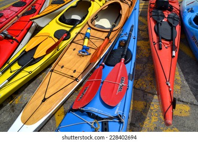 DALKEY, IRELAND - MAY 17: Colourful kayaks arranged across the slipway at Bulloch Harbour on May 17, 2014 in Dalkey, Ireland.