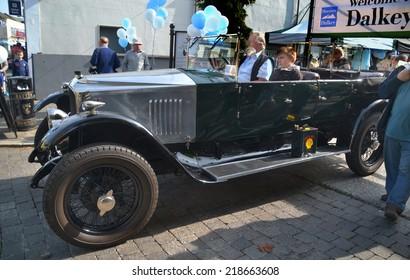 DALKEY, IRELAND - SEPTEMBER 14: An open top vintage car at the Dalkey Vintage Car Rally on September 14, 2014 in Dalkey, Ireland.