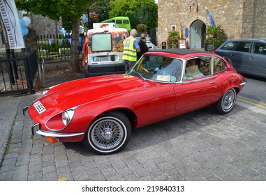DALKEY, IRELAND - SEPTEMBER 14: A vintage E-Type Jaguar coupe arrives at the Dalkey Vintage Car Festival on September 14, 2014 in Dalkey, Ireland.