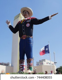 DALLAS, TEXAS—OCTOBER 2017:  Close up shot of the Big Tex statue in cowboy costume who speaks and waves his hands to welcome visitors to the State Fair of Texas carnival grounds in Dallas.
