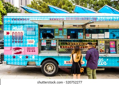 DALLAS - CIRCA JUNE 2014: People visit food trucks in downtown Dallas, Texas.