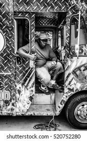 DALLAS - CIRCA JUNE 2014: People visit food trucks in downtown Dallas, Texas.