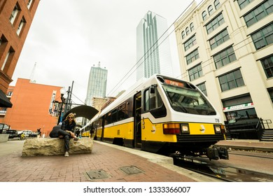 DALLAS - CIRCA MARCH 2018: The Dallas DART light rail train drives through downtown near Deep Ellum in Dallas, Texas.