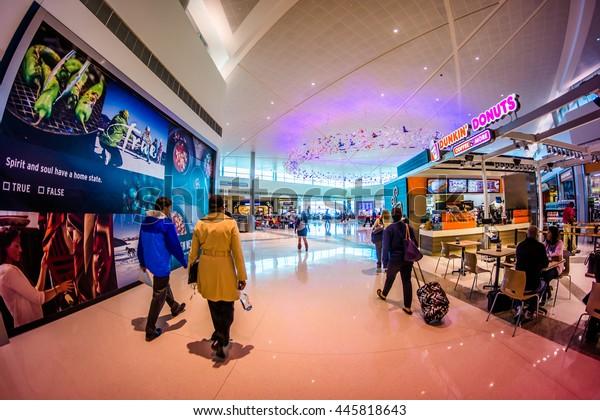 DALLAS - CIRCA October 2014: Travelers walk through the main terminal of Love Field Airport in Dallas, Texas.