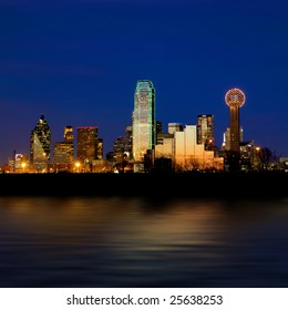 Dallas city skyline at night shot over the Trinity river