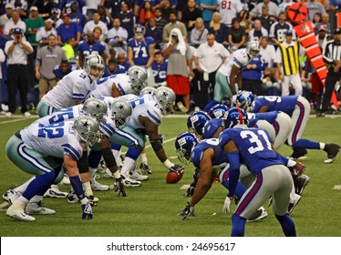 DALLAS - DEC 14: Dallas Cowboys Quarterback Tony Romo waits for the snap from the center during a game held Dec. 14, 2008 in Texas Stadium, Dallas, Texas.