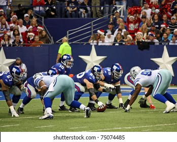 DALLAS - DEC 14:  NY Giants quarterback Eli Manning calls signals and prepares to receive the snap from center in a game with the Dallas Cowboys. Taken in Texas Stadium on Sunday, December 14, 2008.