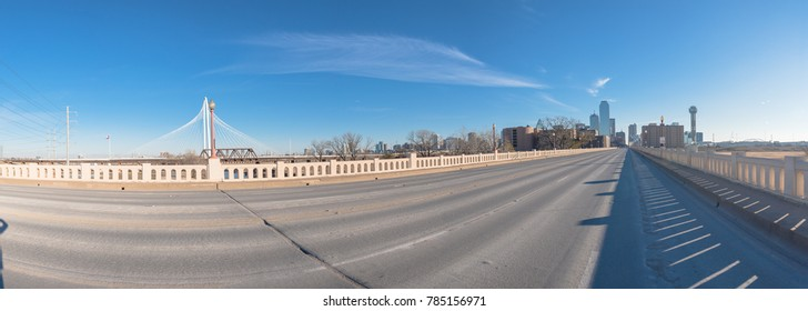 Dallas Downtown skylines and Margaret Hunt Hill Bridge from Commerce Street Bridge under cloud blue sky. Panorama.