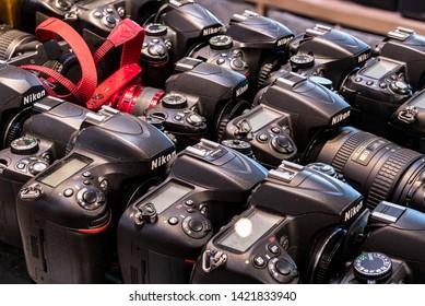 Dallas, Oregon - June 7, 2019: Used DSLR camera bodies lined up for sale.