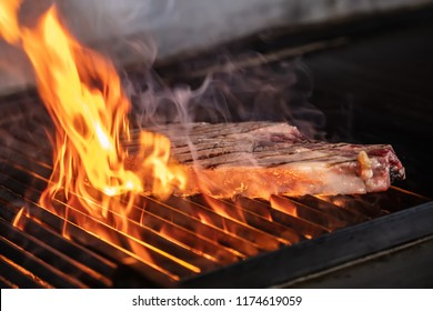 Dallas Steak (beef chops) on a BBQ. Dallas and T bone cooked on the grill Meat steak rested.