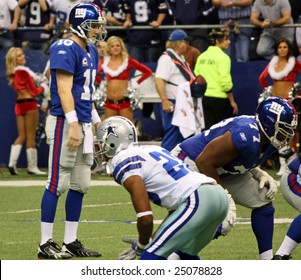 DALLAS, TEXAS - DEC 14: New York Giants Quarterback Eli Manning prepares to receive the snap from center during a game with the Dallas Cowboys in Texas Stadium located in Dallas, Texas. The game took place on  Sunday, December 14, 2008.