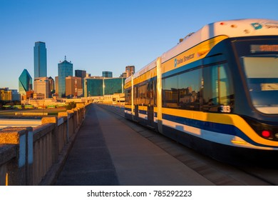 DALLAS, TEXAS - DECEMBER 10, 2017 -  Moving streetcar on the Houston Street Viaduct with the city of Dallas in background. The Dallas Streetcar is a 2.45-mile modern streetcar line in Dallas, Texas.