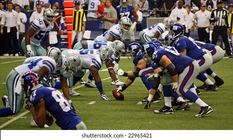 DALLAS, TEXAS - DECEMBER 14, 2008: Eli Manning and the NY Giants lineup against the Dallas  Cowboys in the Texas Stadium.