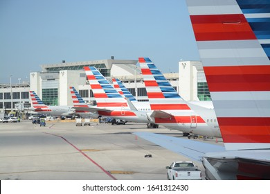 Dallas Texas DFW , U.S.A. 2018-January-23rd - Tail wings of American Airlines lined up in a row at their gates