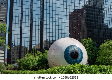 Dallas, Texas - May 7, 2018: The Eye is a statue in downtown Dallas, Texas located at the Joule Hotel.