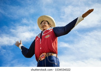 DALLAS, TEXAS - October 17, 2019: Closeup of the Big Tex statue. The figure icon greets and waves his hands to welcome visitors at the State Fair of Texas fairgrounds.
