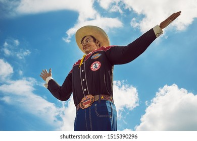 Dallas, Texas - October 5, 2017: Big Tex statue at Fair Park. The figure icon greets and waves his hands to welcome visitors at the State Fair of Texas fairgrounds.