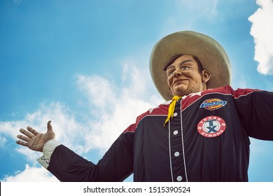 Dallas, Texas - October 5, 2017: Closeup of the Big Tex statue. The figure icon greets and waves his hands to welcome visitors at the State Fair of Texas fairgrounds.