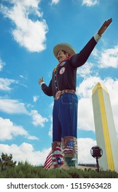 Dallas, Texas - October 5, 2017: Big Tex statue standing tall at Fair Park. The icon greets and waves his hands to welcome visitors at the State Fair of Texas fairgrounds.