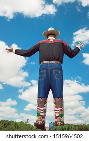 Dallas, Texas - October 5, 2017: Big Tex statue standing tall at Fair Park, back side. The icon greets and waves his hands to welcome visitors at the State Fair of Texas fairgrounds.