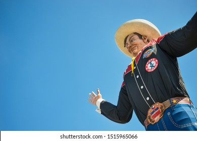 Dallas, Texas - October 5, 2017: Closeup of Big Tex statue at Fair Park. The icon greets and waves his hands to welcome visitors at the State Fair of Texas fairgrounds.