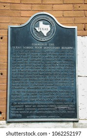 Dallas, Texas - September 2009: Close up view of a plaque on the wall of the Texas School Book Depository building  which is now a museum about the assassination of President John F Kennedy.