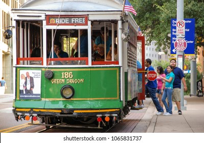 Dallas, Texas - September 2009: Close up view of people boarding a streetcar on the McKinney Avenue trolley system which is also know ans the M-Line Trolley