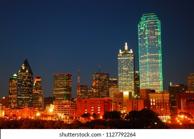 The Dallas Texas Skyline glows against a Dusk sky