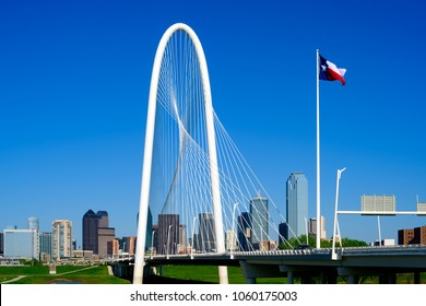 Dallas, Texas Skyline with Margaret Hunt Hill Bridge in the foreground. Clear blue sky background.