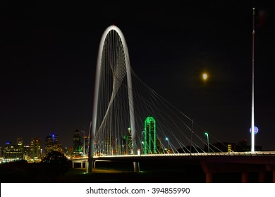Dallas Texas Skyline. Nightscape as viewed across the Trinity River East toward Downtown. Taken during 2015 Lunar eclipse. Partial Eclipse visible in sky.