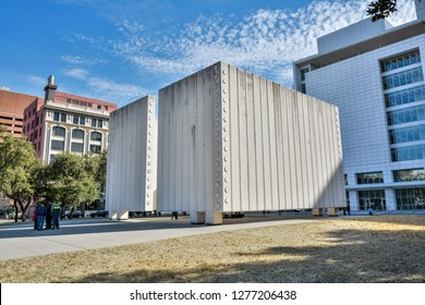 Dallas, Texas, United States of America - December 31, 2016. Kennedy Memorial in Dallas, TX, with people and surrounding buildings.