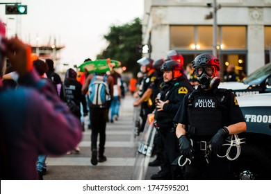 Dallas, Texas / United States - May 30 2020: Protestors march through streets of Dallas to protest the death of George Floyd and speak out against police brutality on May 30, 2020.