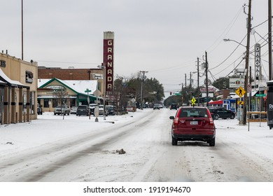 Dallas, Texas \ USA 02-17-2021 Lower Greenville Ave with Granada Theater in view during the recent snow storm and extreme cold weather in Dallas, Texas.