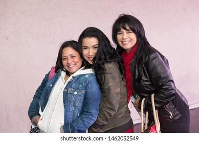 Dallas, Texas / USA - December 20, 2014: Group Portrait of Three Beautiful Hispanic Women Smiling