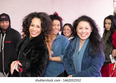 Dallas, Texas / USA - December 20, 2014: Group Portrait of Three Beautiful Hispanic Women Smiling and Standing in Line