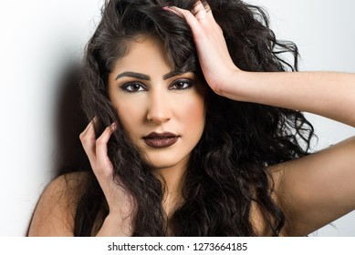Dallas, Texas / USA - Feburary 21, 2017: Close up Portrait of a Beautiful Hispanic Model with Her Hands Caressing Her Head and Face