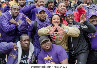Dallas, Texas / USA - March 23, 2013: Men of Omega Psi Phi Fraternity and a woman from the Delta Sigma Theta Sorority at the Mayor Mike Rawlings of Dallas Rally Against Domestic Violence