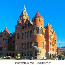 DALLAS, TEXAS, USA - OCTOBER 23, 2017. Beautiful facade of Old Red Museum. Brick building in castle style on blue sky background. The town square Dealey Plaza in Dallas.